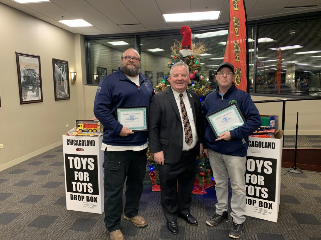 Teamsters Local 731 President Terrence J. Hancock recognized Members Jason Haynes and Perry Harris for their hard work collecting toys for Chicagoland Toys for Tots
