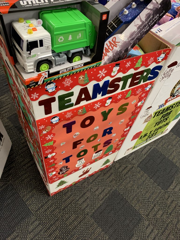 Among the dolls, games, and sports equipment inside the boxes, the Teamsters donated plenty of toy trucks to be given to little boys and girls